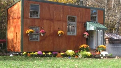man builds tiny house       family