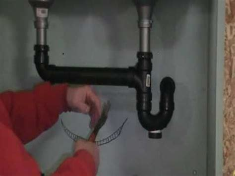 replacing drain pipes kitchen sink the plumber shows how to install drain pipes on a 9234