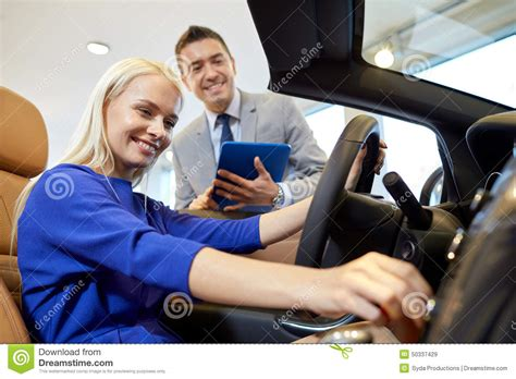 Happy Woman With Car Dealer In Auto Show Or Salon Stock