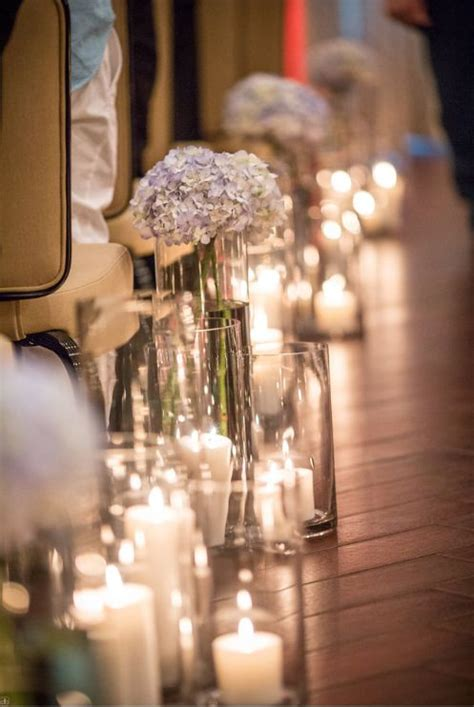 candlelit wedding ceremony candles  votives lining