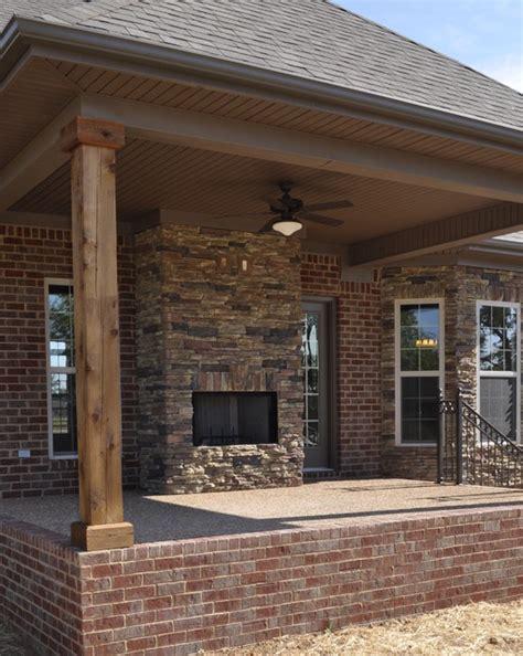 exterior stone fireplace  cedar posts contemporary
