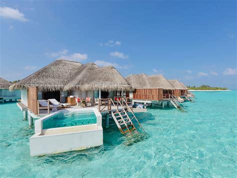 chambre sur pilotis maldives hôtel kanuhura maldives atoll de lhaviyani réservation