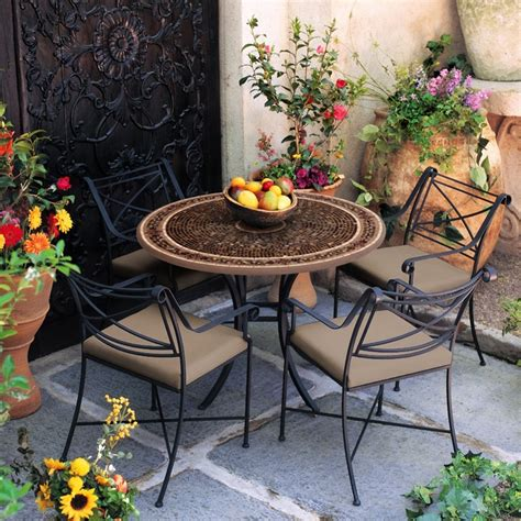 this iron mosaic patio set is for an outdoor