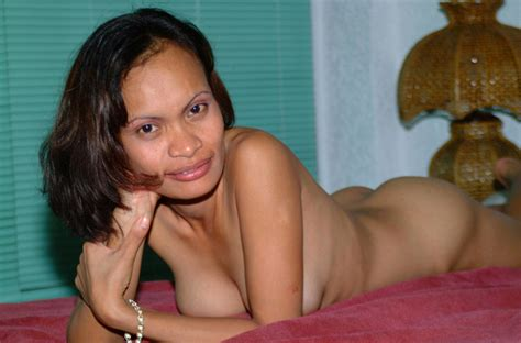 mature girlfriend naked on her bed