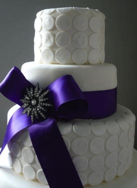 tier white wedding cake  white coins  large