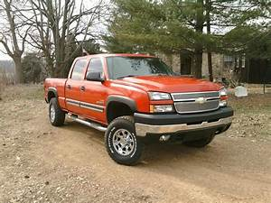 2003 And 2006 Chevy Duramax Both Are Red  Crew Cab  Short