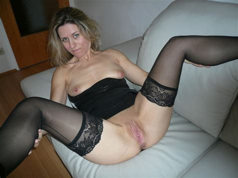 Milf In Stockings Stripping And Spreading Her Legs