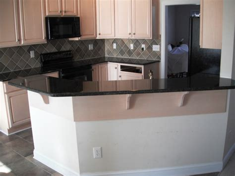 uba tuba granite  great  white cabinets