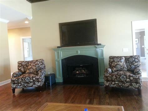 custom mantle  inset tvpainted  fireplace