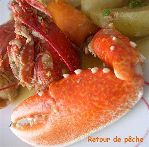cuisiner homard congelé homard breton en cocotte aux legumes nouveaux recette