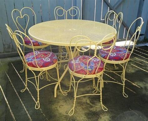 Cool way of upholstering old iron dining chairs. I would