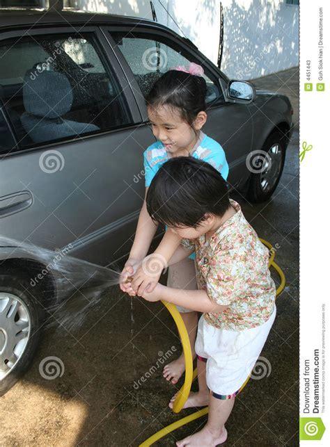 kids washing car stock  image