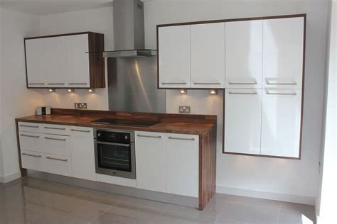 do kitchen cabinets go in before flooring high gloss white kitchen backsplash tags awesome glossy 9859