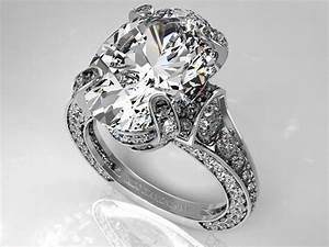 Engagement ring large oval diamond cathedral graduated for Big oval wedding rings