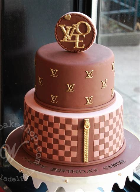 tiered louis vuitton logo cake  whipped bakeshop