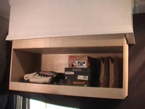 ceiling cabinet  automatic shelf lift youtube
