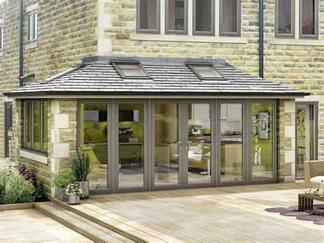 sunroom attached to house modern grey conservatory attached to a stone house with wood decking in front of it sunrooms