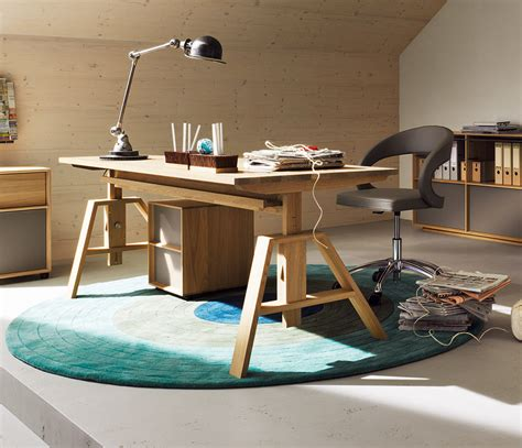 Comfort Knows No Limits  Heightadjustable Desk Designs