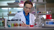 Female scientist working with scientist tablet. Woman ...