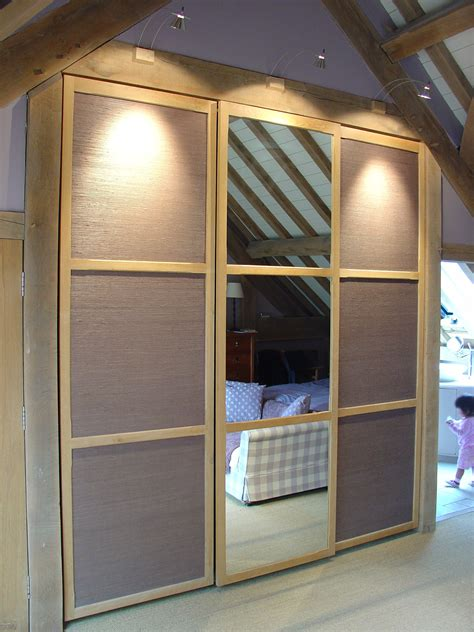 Wallpaper For Cupboard Doors by Sliding Wardrobe Doors With Inset Mirror Textural