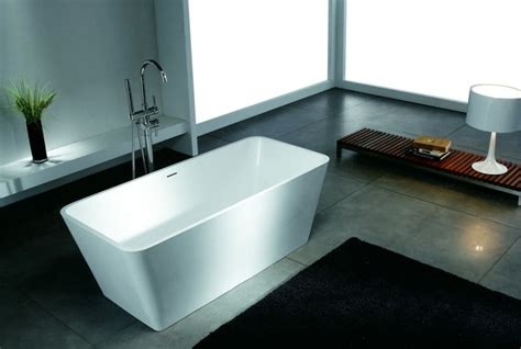 square bathtub design for contemporary bathroom with black rugs on the grey marble tiles floor