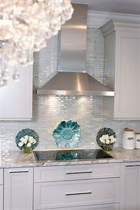 glass backsplash tiles Iridescent glass tile by Lunada Bay. Stainless hood with taupe cabinets. Color looks good ...