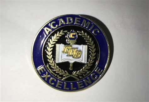 New Honor Roll Achievement Pins Designed By Student