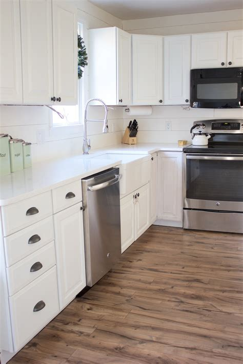 Kitchen Progress: Pergo Flooring Before and After   Lauren