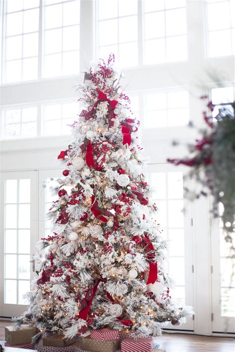 flocked christmas tree decorating ideas my home for the holidays pink peonies by rach parcell