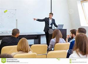 Speaker Giving Presentation At Business Conference Stock