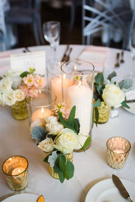 pillar candle centerpiece with gold floral bud vases life