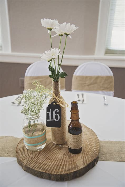 rustic diy tree stump centerpieces  twine wrapped beer