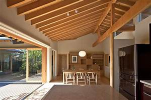 Timber Framed Japanese House Built Around Private Gardens