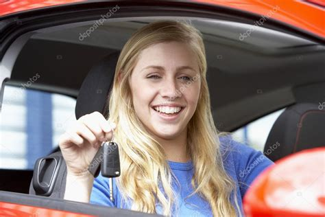 Teenage Girl Sitting In Car, Holding Car Keys And Smiling