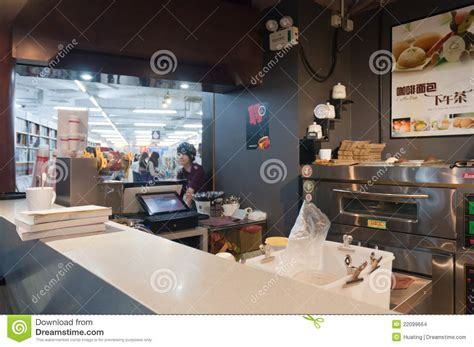 Welcome to editions coffee shop & bookstore. Coffee shop in book store editorial stock image. Image of afternoon - 22099664