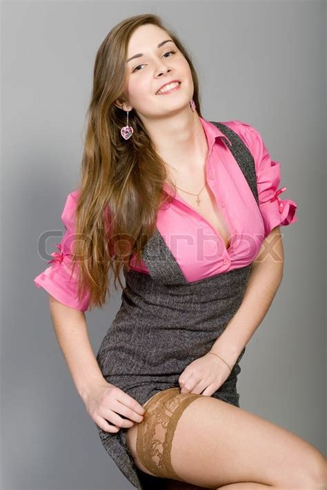 young beautiful girl corrects  stock photo