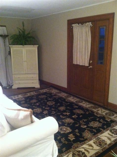 Living Room With Door In Middle by Front Door Opens In Middle Of Living Room Splits Room In