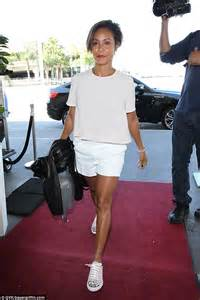 Jada Pinkett Smith flashes legs in shorts at airport ...