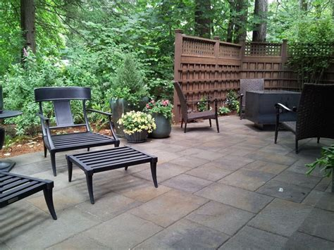 belgard lafitt rustic slab patio with custom fencing and