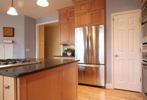 light blue walls with maple cabinets countertops and