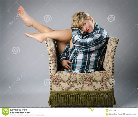beautiful woman  ugly  chair stock photo image