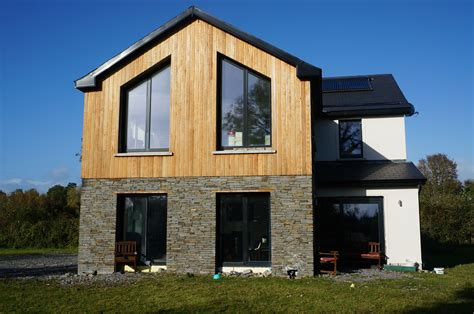 Passive House, Larch cladding, dressed stone and white ...
