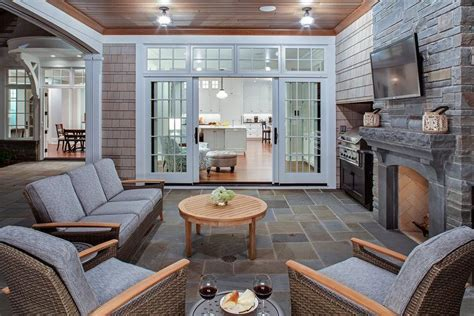 covered patio with fireplace transitional deck patio