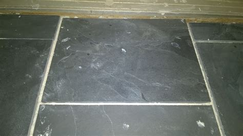 removing dried mortar from slate tiles orbited by nine