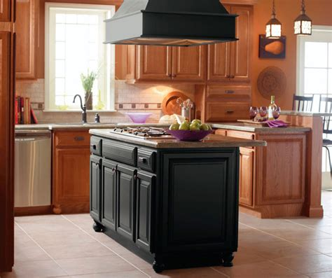 kitchen islands cabinets light oak cabinets with black kitchen island kemper