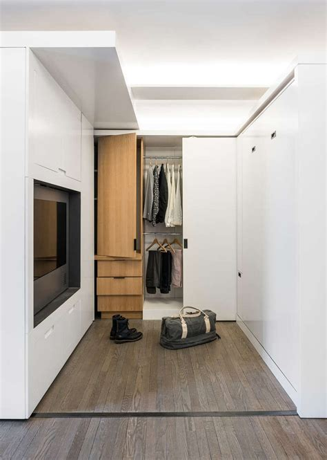 small apartment utilizes  sliding wall  hide  functions