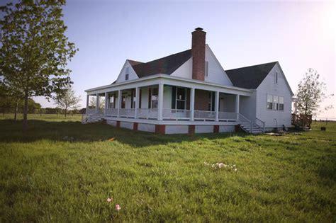 farmhouse with wrap around porch rockin farmhouse w wrap around porch in texas 6 hq pictures metal building homes