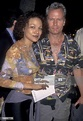 Actor John Savage and wife Sandi Schultz attend the U Turn ...
