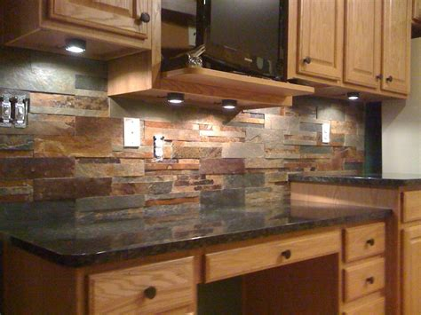 this slate tile backsplash is shown with uba tuba granite back splash