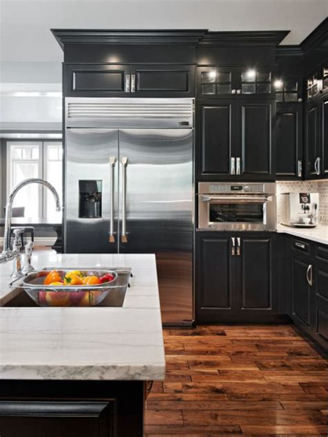 kitchen cabinet magazine black cabinets with white granite counters and distressed 2602